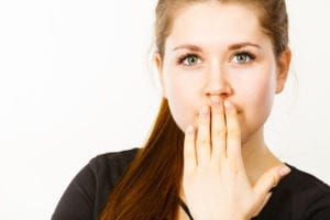 woman covering her mouth with her hand.