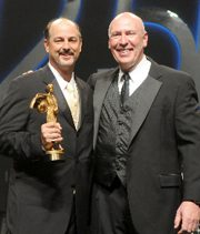 Photo of Dr. Lesage accepting a 2009 AACD Excellence Award.
