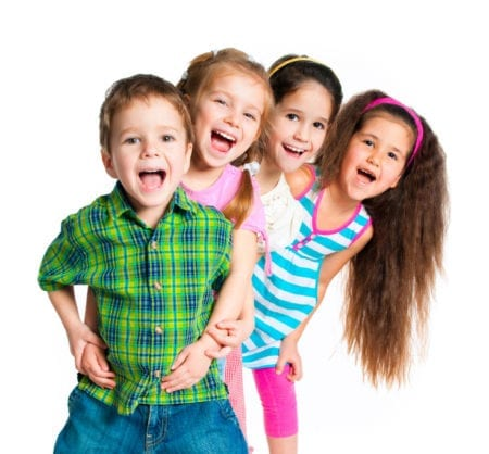 4 small children smiling with their mouths open