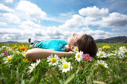A woman laying in a field of flowers