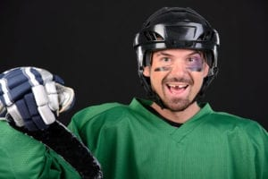 Hockey player with a missing tooth