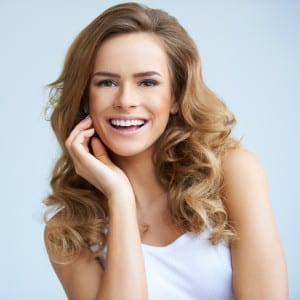 woman with beautiful smile with porcelain veneers