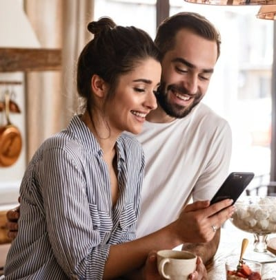A couple looking at a phone app together