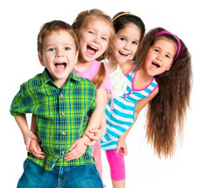 A photo of 4 young children smiling and laughing and ready for their first visit to a pediatric dentist.