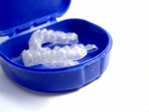 Two teeth whitening trays in a blue case