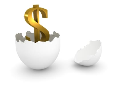 dollar sign hatching out of a cracked egg