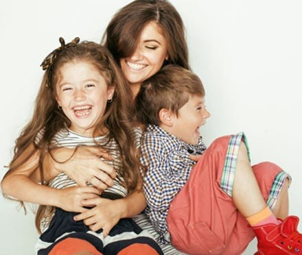 Mother lauging with her son and daughter